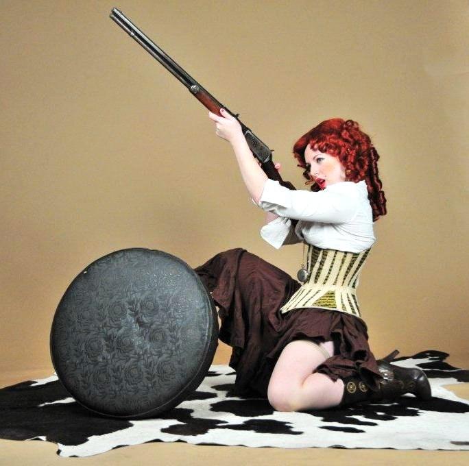 Female model photo shoot of the Madhat Kat by Shovelhead Studios in Omaha, NE