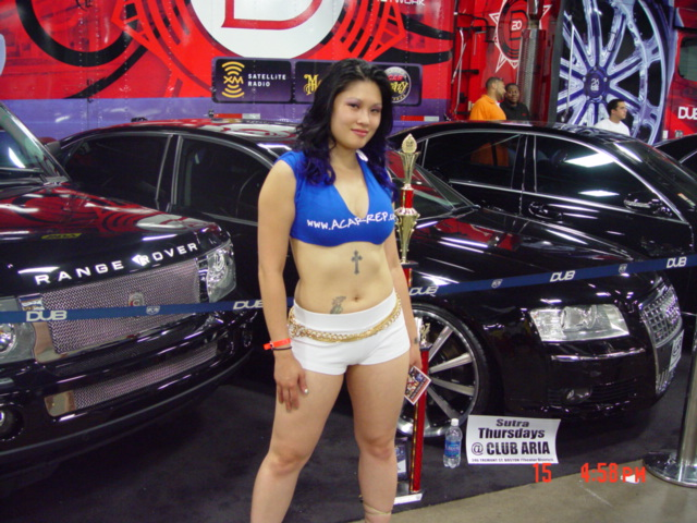 Male model photo shoot of Goldenmind in boston car show