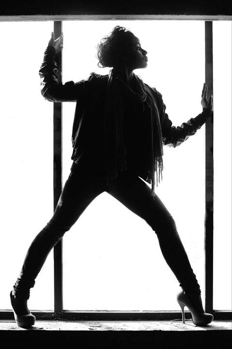Female model photo shoot of Tarin Calmeyer in Abandoned warehouse