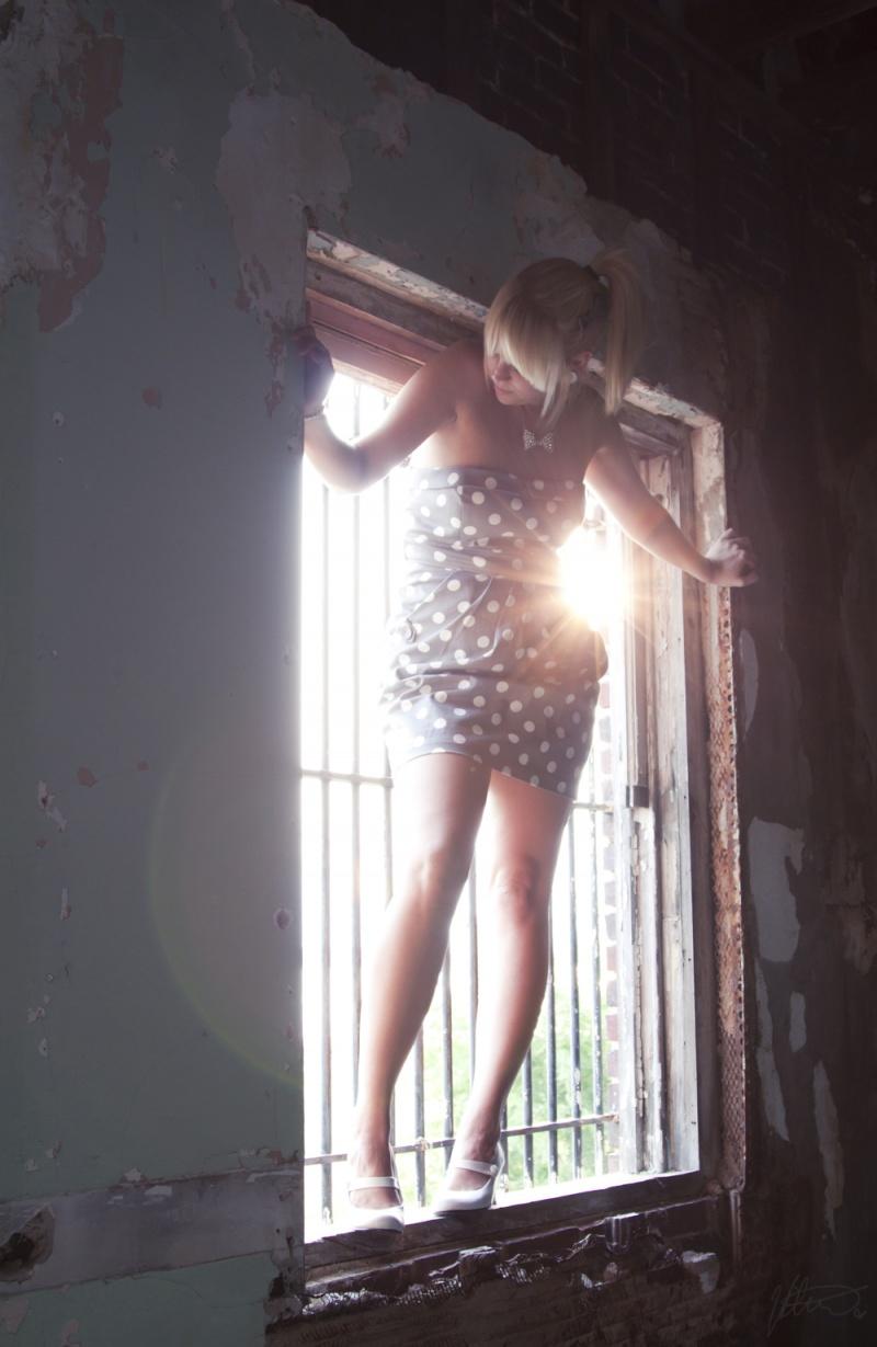 Female model photo shoot of B L I T H E in abandoned bank.