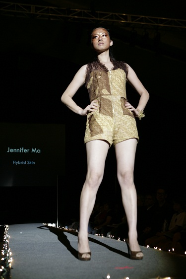 Female model photo shoot of Blessed Coral in Runway Designers Club Fashion Show