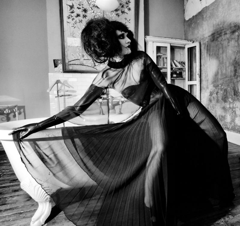 Female model photo shoot of Haute Noir and Erica Krasickaite