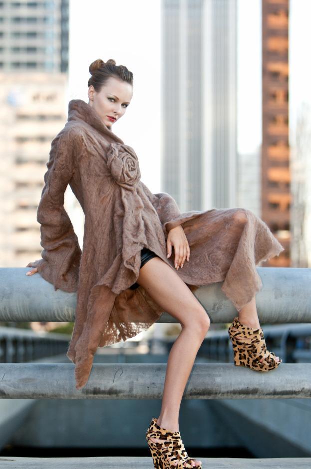 Female model photo shoot of Lovely Retouching