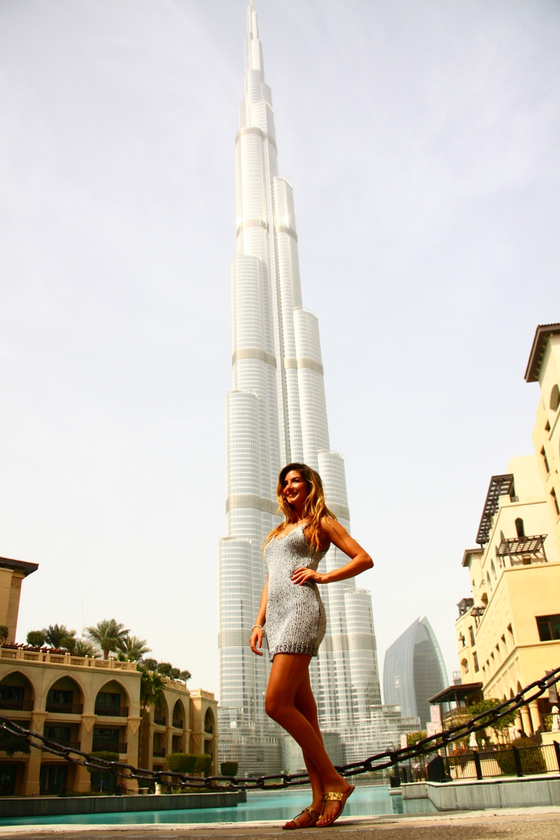 Dubai, UAE Feb 10, 2012 Double-K Photos Jade in front of the tallest building in the world.