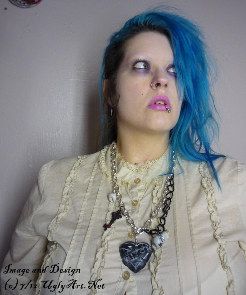 Jennings, LA Jul 27, 2012 2012 http://www.etsy.com/shop/uglyartdotnet Self Portrait modeling one of my handmade WITCH necklaces.