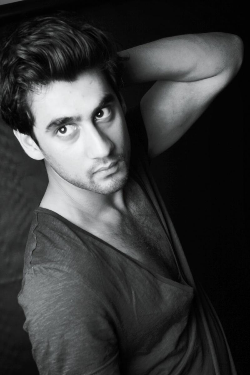 Male model photo shoot of MUSHAF KHAN in liverpool studio