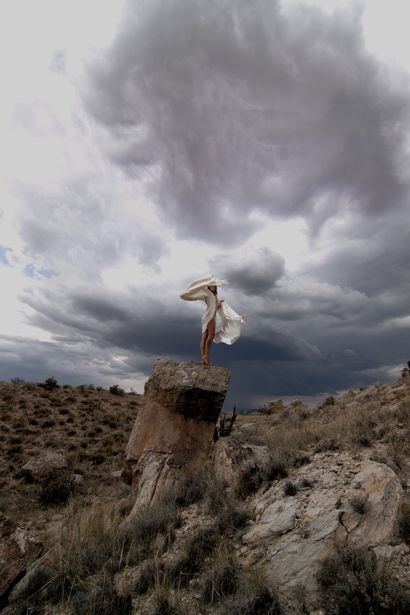 This was not a planned shot.  The clouds were building when she arrived so before she knew what hit her she was up on the rock in my back yard.  We only had a few minutes as the storm was coming in fast.  She was awesome! Aug 25, 2012 Grays Of Shade Photography A Storm Is Brewing