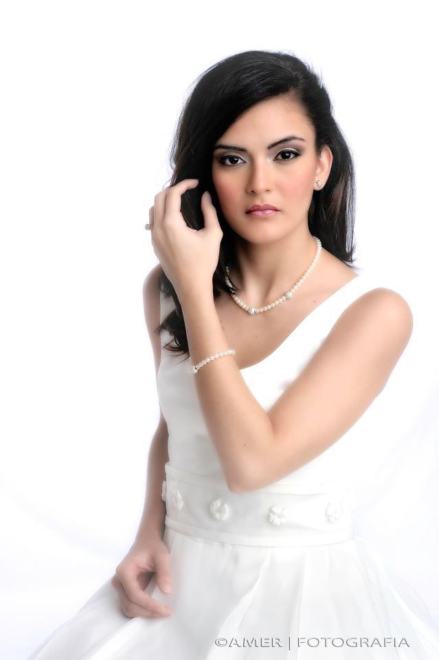 Female model photo shoot of Relllys by amer-fotografia, makeup by Michelle Rivera MUA