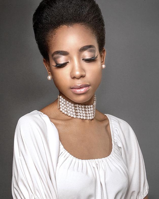 Female model photo shoot of KaliDaSkope Beauty