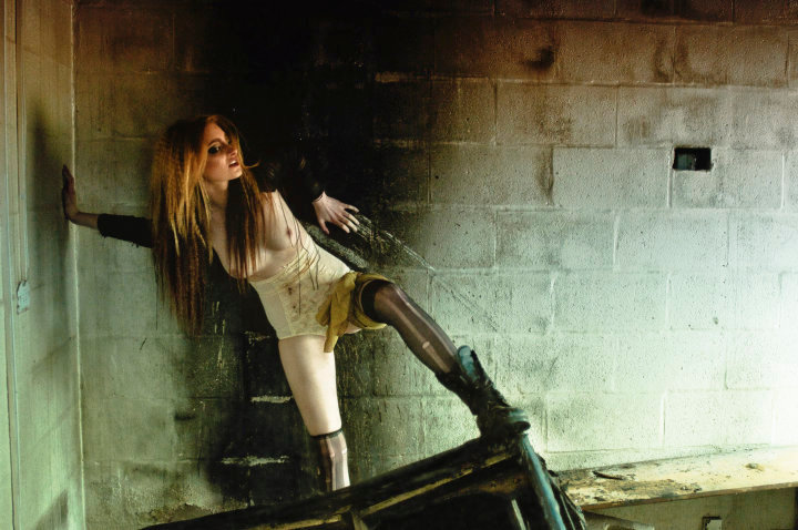 Female model photo shoot of Sammy Karpf in Mental asylum