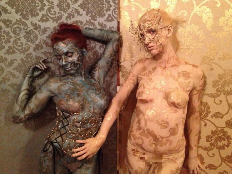 Female model photo shoot of Coralia, body painted by Bombshell Body Art