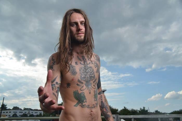 Male model photo shoot of James J Murning in Vans Warped Tour
