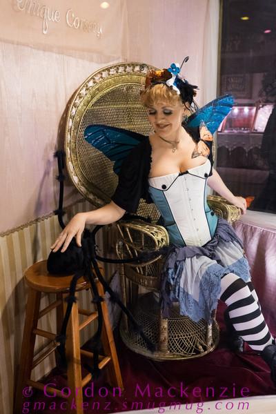 Female model photo shoot of Stefani Arlene in Dark Garden Corsetry