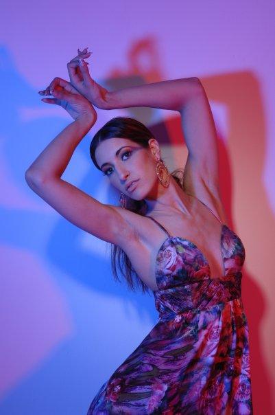 Female model photo shoot of -Debrah-, clothing designed by Sulaimi Brookman
