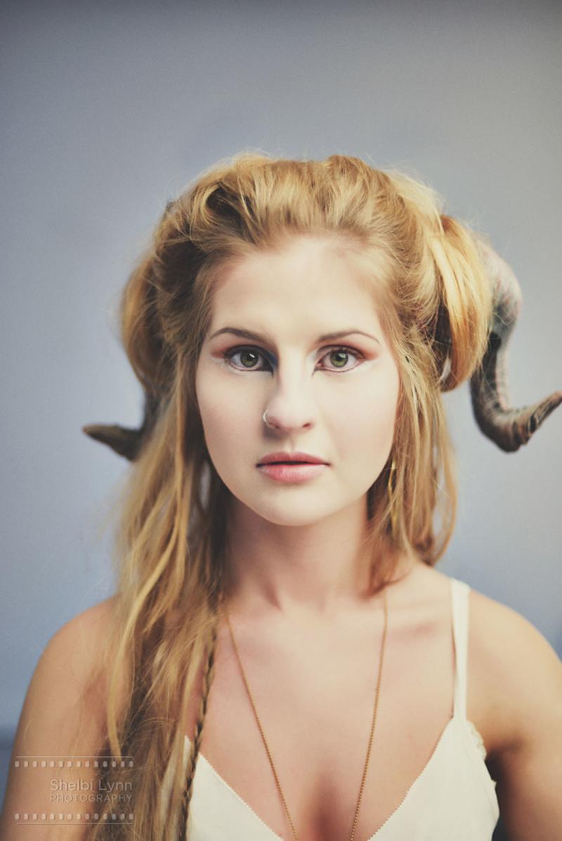 Female model photo shoot of ShelbiLynn Photography