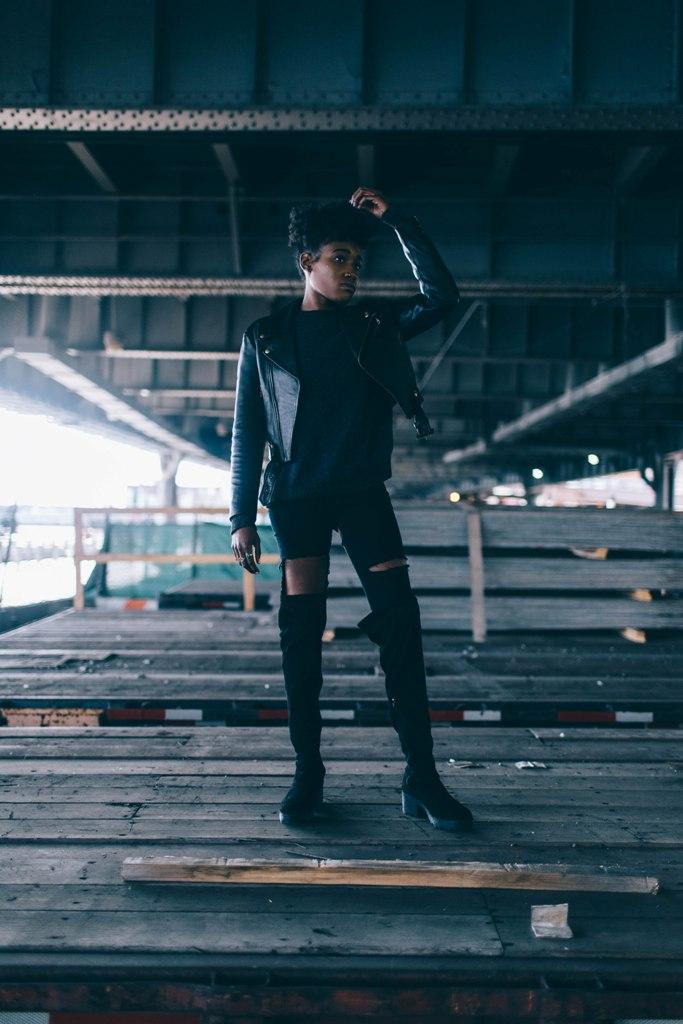 Female model photo shoot of Nilysha Milligan in Under the Brooklyn Bridge