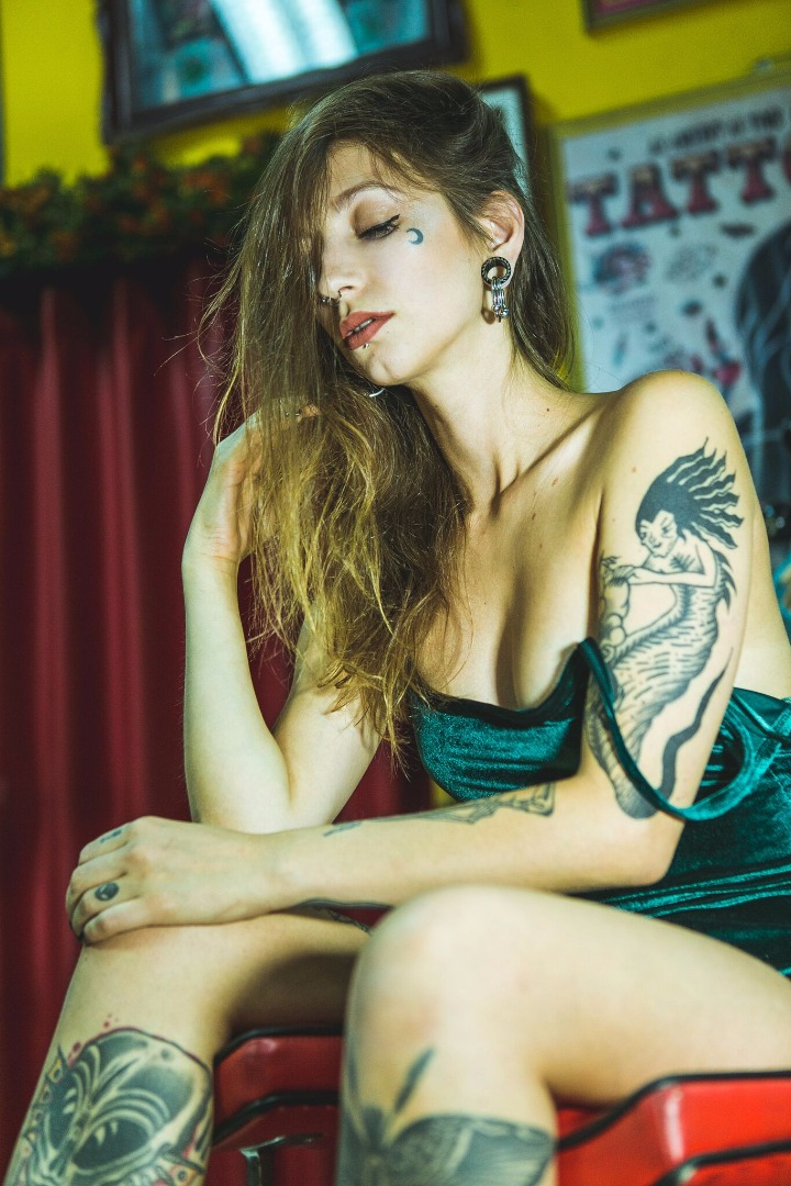 Female model photo shoot of Demonia SG by macedo in Bad Bones Tattoo & Piercing studio