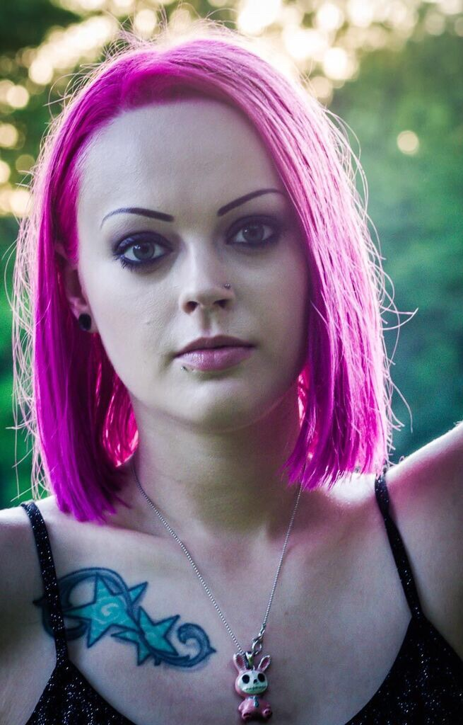 Female model photo shoot of Meana Rose in Hines park