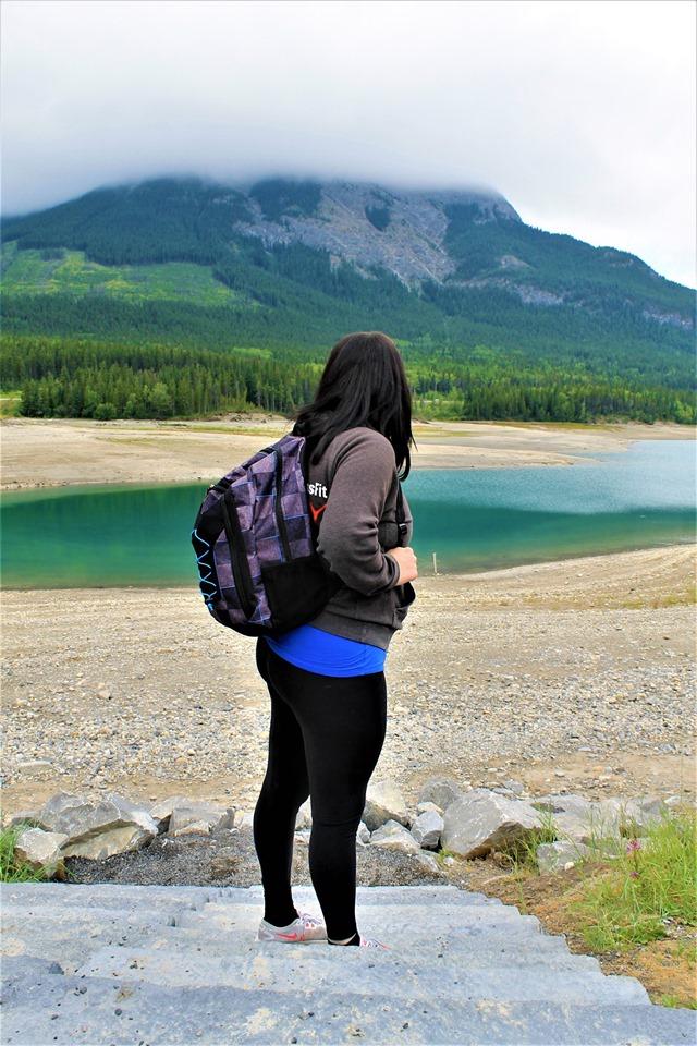 Female model photo shoot of Krista Isobell in Barrier Lake, Kananaskis, Alberta, Canada.