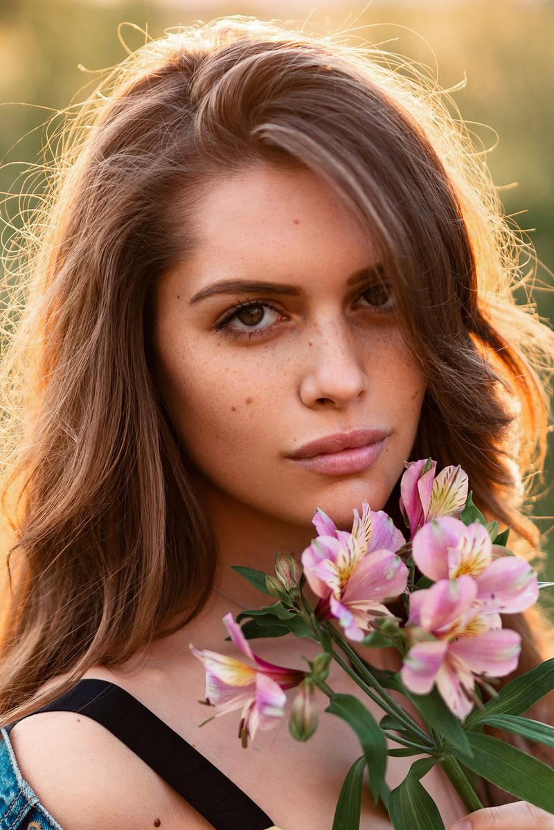 Female model photo shoot of Dilz Photo Retouch